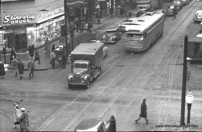 CTA 4297 at Clark and Madison in the early 1950s. The PCC is on Clark. This must be winter, as some women are wearing fur coats. Back then, a fur coat was a real status symbol, mink especially. Clark was still a two-way street at this point. In the early 1950s, it was converted to one-way southbound, and Dearborn to northbound.