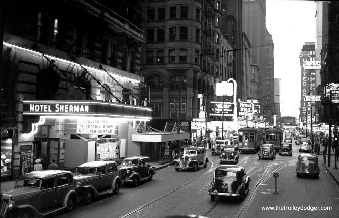 CSL 3010 is westbound on Randolph in Chicago's Loop. The film Holiday, starring Katherine Hepburn and Cary Grant, is on one of the theater marquees, which dates this picture to 1938. Besides the Hotel Sherman, we can see the Oriental, United Artists, and Woods theaters, plus Henrici's restaurant.