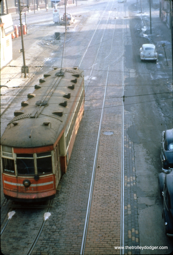 "This birds-eye view of CTA 1744 was taken from the Pulaski Road ""L"" station on the Garfield Park branch in April 1950. However, what we are looking at may actually be a Madison-Fifth car at the west end of its route, ready to loop back via Pulaski and Harrison. Bill Shapotkin adds, ""This image is looking E-N/E on Fifth Ave from the Garfield Pk 'L'...no question about it. The intersection behind the streetcar is Harrison."""