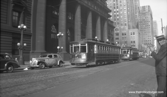 CSL Pullman 127 passes the old North Western Station on Madison on August 18, 1941, while a man in a straw hat wonders why anyone would want to take a picture of a streetcar.
