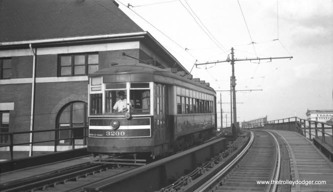 CTA 3200 heads east on the Roosevelt road extension over the IC tracks, which ran to the Field Museum and Soldier Field. By this time, streetcar service on Roosevelt had been reduced to a shuttle operation between Wabash and the Museum Loop. This picture was taken in May 1952, and the shuttle was discontinued the following year.