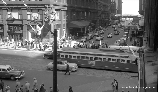 CTA 7251 at State and Washington in August 1948. That's one of the iconic Marshall Field's clocks at left.