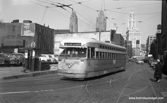 CTA PCC 4100, built by Pullman, is turning from Kinzie onto Clark in November 1953, with Tribune Tower and the Wrigley Building at rear.