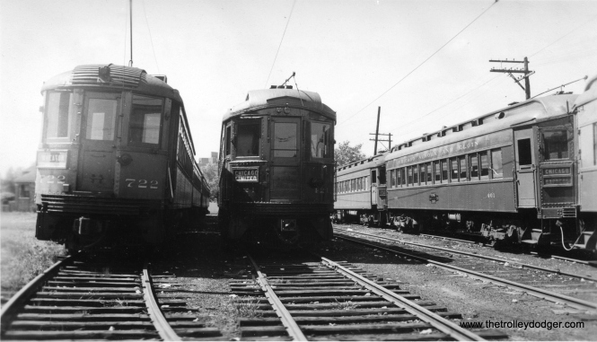 "Here is a very rare photo taken at Laramie Yards in 1936. At left we see North Shore Line car 722, heading up a four-car train and signed for Wheaton. CNS&M cars did, of course, operate on parts of the Chicago ""L"" system, of course, but this is the first picture I have seen showing them at this location, posed next to CA&E cars 421 and 401. 722 was buit by Cincinnati Car Co. in 1926. I wonder what the occasion was that brought four North Shore Line cars to Wheaton? (Edward Frank, Jr. Photo)"
