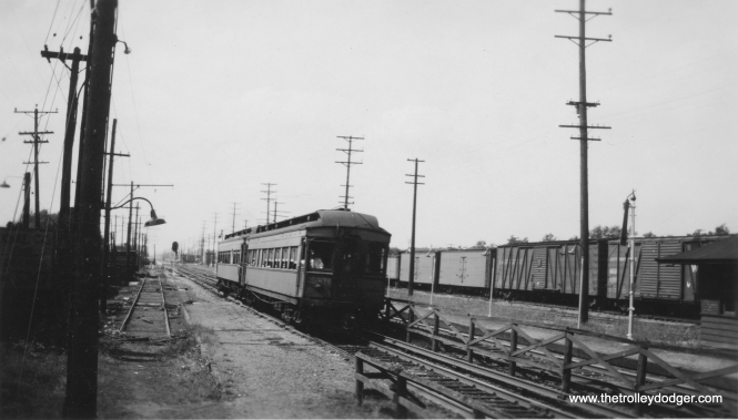 A two-car train of CA&E woods at the Bellwood station. (Edward Frank, Jr. Photo)