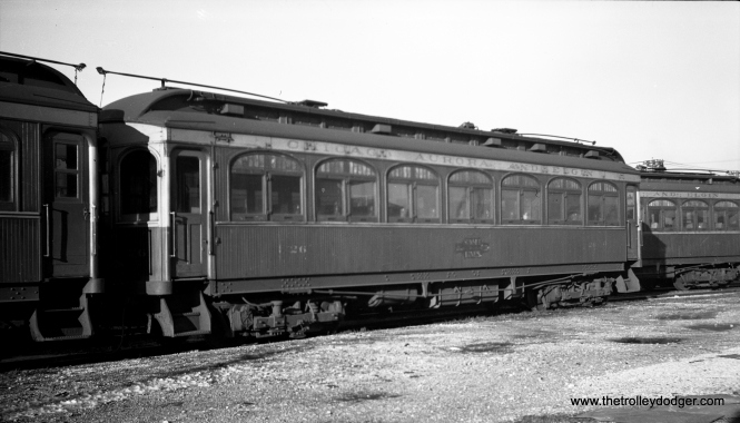 "CA&E wood car 26 in Aurora. Don's Rail Photos notes: ""26 was built by Niles Car in 1902. It was modernized in June 1943 and retired in 1959."""