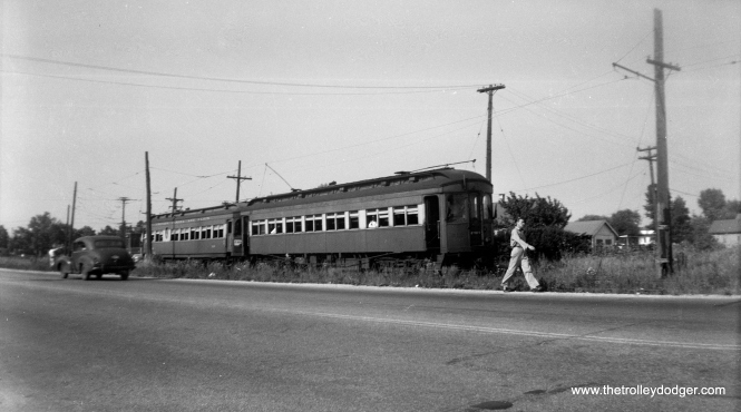 "A two-car train of 300-series woods on a July 8, 1949 fantrip. From the ""side of the road"" location under wire, I would guess this is the Mt. Carmel branch along Mannheim Road."