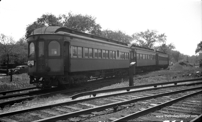 """CA&E 311 at the CTA aramie Avenue Yards on May 17, 1948. This shows a small area in the yards where CA&E could store a few trains in mid-day for use in the afternoon rush hour. I am pretty sure those 1920s Chicago bungalows at left are still there. Don's Rail Photos adds, """"311 was built by Kuhlman Car Co in 1909, #404. It was modernized at an unknown date."""""""