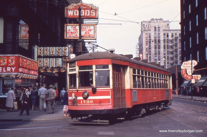 "CTA 1758 at Randolph and Clark in the 1950s, with the Woods Theater in the background. It closed in 1989. ""The Beauty and the Outlaw,"" playing at the Woods, is more typically known as Ride, Vaquero!. This western starred Robert Taylor and Ava Gardner and was released on July 15, 1953, which helps date the photo."