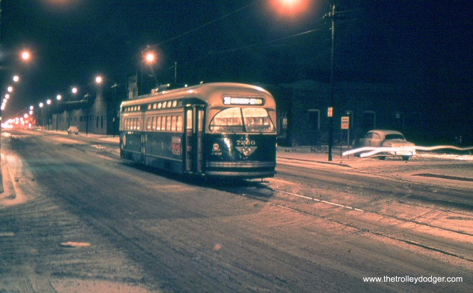 "CTA 7260 at 119th and Morgan. One of our regular readers writes, ""I seem to recall that this photo was taken by Bill Janssen on December 4, 1955, the last day (early morning) that route 36 Broadway-State still existed. It is a Broadway-State car laying over, waiting to head north to Clark and Schreiber. It is not Broadway and Ardmore."" We were only going by what was written on the slide, which appears to be in error, thanks. This picture appears to be a time exposure (see the light streaking at right). My guess is that the photographer had his camera on a tripod, and used an exposure time of a few seconds for each picture."