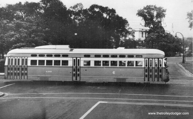 "CTA 4160 on Madison near the Garfield Park field house. George Trapp notes, ""CSL PCC #4160 on Madison, while photographed on Madison in Garfield Park, this is a publicity photo. The side sign reads Clark-Wentworth and was probably taken in the summer of 1947 before cars in this series, although not necessarily this one, went to Madison."""