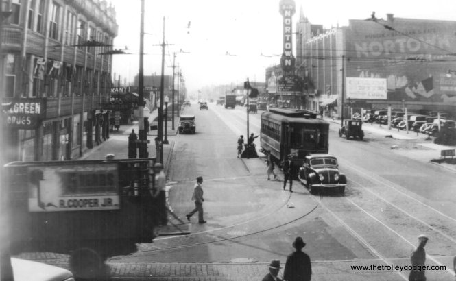 A CSL streetcar at Western and Devon in the 1930s, near the old Nortown Theater. That appears to be a Chrysler Airflow in front of the streetcar.