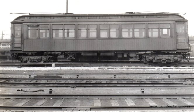 "A CTA wooden ""L"" car, signed as a Lake Street ""B"" train."