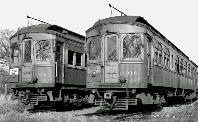 Here's a head-on shot of CA&E cars 48 (Stephenson 1902) & 316 (Jewett 1913).
