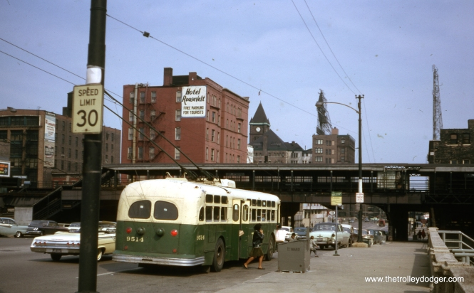 "Passengers get off CTA trolley bus 9514, which is heading eastbound on Roosevelt at State in April 1964. The Roosevelt Road station on the South Side ""L"" was closed as of January 1963, when the North Shore Line quit. From 1949-63, NSL had exclusive use as N-S trains were routed through the State Street subway. These tracks were put back into regular service in 1969, with the opening of the Dan Ryan line, but the station was demolished and was not replaced by a new one until 1993, with the opening of the Orange Line."