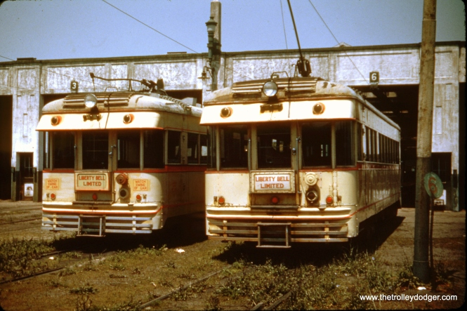 "A rear view of two Lehigh Valley Transit ex-Cincinnati & Lake Erie ""Red Devils"" shows how their squared-off ends were not designed for multiple-unit operation. By comparison, car 1030, adapted from Indiana Railroad car 55, had a rounded end and was designed for multiple unit operation. Presumably, this is the Fairview car barn in Allentown. Liberty Bell Limited interurban service ended in 1951."