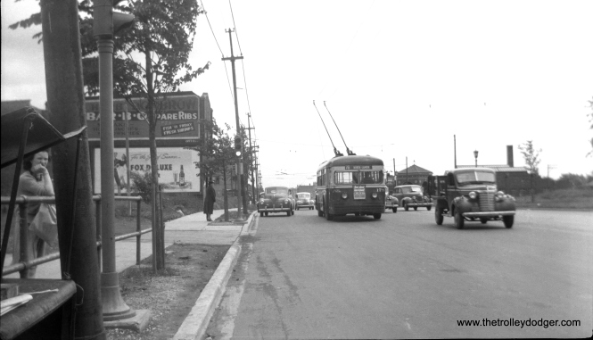 "Here, we see a rare shot of a CSL trolley bus on North Avenue in 1940. While route 72 - North was not converted to trolley bus until July 3, 1949, there was wire between the garage near Cicero Avenue and Narragansett. TBs ran on Narragansett until 1953, when route 86 was combined with the one-mile extension of North between Narragansett and Harlem. This TB is signed for route 76 (Diversey), which used TBs until 1955. The destination sign also says North-Lamon, site of the garage, but the slope of the street would indicate the bus is actually heading west. There is TB wire special work turning off to the right in the background, perhaps indicating that the bus has just left the garage. Andre Kristopans: ""I THINK WB about Lavergne, pulling out."" There would be streetcar tracks on this section. Andre again: ""There are car tracks. You can barely see a couple of hangers to the right of the bus. North Av is very wide at this point, almost 6 lanes, and TT's did not share wire."""