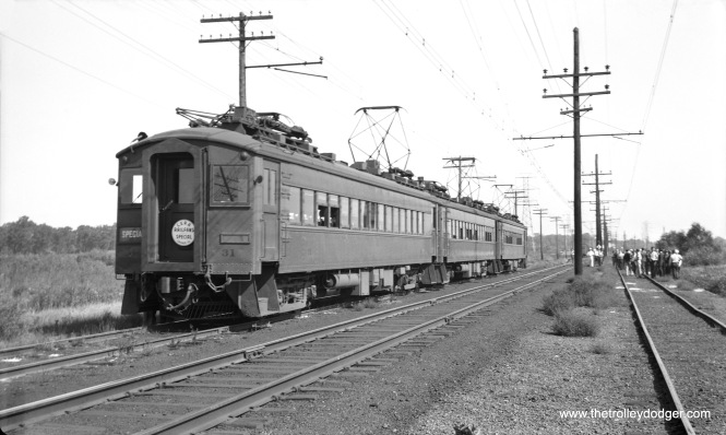 "Chicago, South Shore & South Bend car 31 and train at Wilson, Indiana, on an early CERA fantrip (possibly September 20, 1942). Mitch adds, ""The photo of the South Shore Line fan trip, 1942 in this episode of ""The Trolley Dodger,"" appears to be at Power Siding, between Sheridan and the Highway 12 crossing west of Michigan City."""