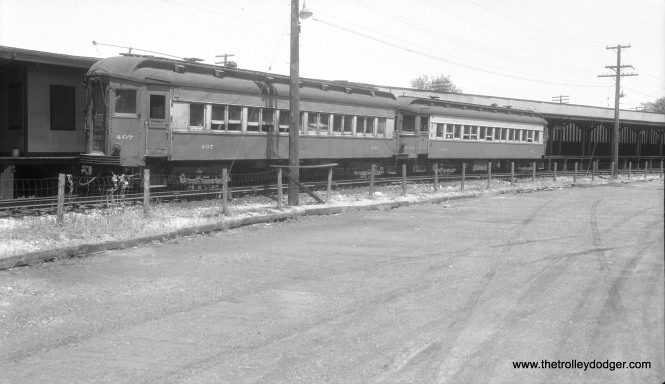 "Chicago, Aurora & Elgin cars 407 and 432 at the Forest Park terminal in September 1955. CA&E service was cut back to here two years earlier. 407 was a Pullman, built in 1923, while 432 was a 1927 product of the Cincinnati Car Company. Riders could change here ""cross platform"" for CTA Garfield Park ""L"" trains."