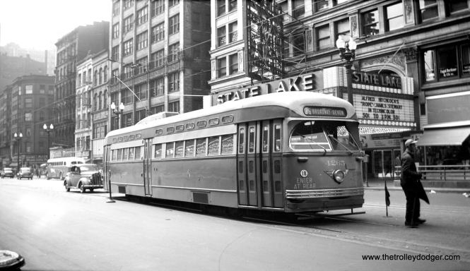 CTA PCC 4265, a Pullman product, heads north on State at Lake circa 1948, while Alfred Hitchcock's film Rope plays at the State-Lake Theater. This has since been converted into production facilities for WLS-TV.