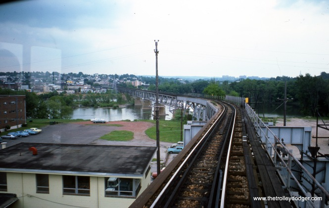 "A ""railfan seat"" view out the front or back window of a Norristown train on the Schuylkill River bridge in May 1976."