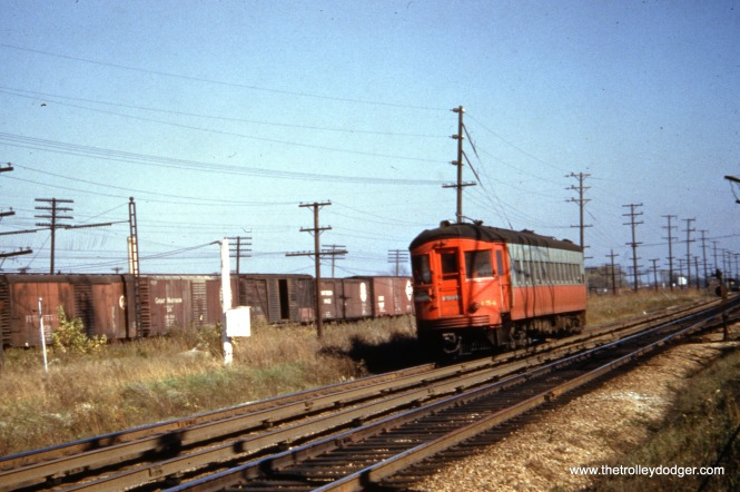 CA&E 454. Methinks this is Bellwood, near 25th Avenue, where the nearby Chicago Great Western had a freight yard.