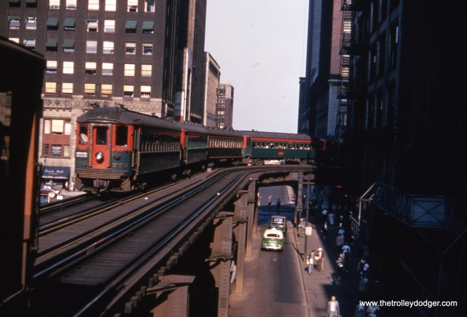 "North Shore Line car 773 and train on the Loop ""L"". The car is signed as a Chicago Express on the Shore Line Route, which was abandoned in July 1955."