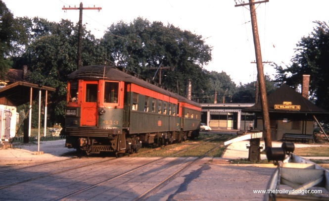 We ran another version of this image in a previous post, but this one is better because there is less cropping. A northbound CNS&M Shore Line Route train, headed up by 413, at the downtown Wilmette station in June 1954. The Shore Line was abandoned not much more than one year later. We are looking to the southeast.