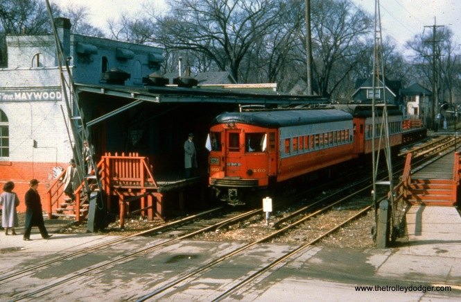 CA&E 460 is at Fifth Avenue in Maywood on March 6, 1958. This was one of a handful of fantrips that were run after passenger service was abandoned on July 3, 1957. The second car may be 417. This was about as far east as trains could go at this point, as the CA&E's suspension of service had facilitated construction of what we now know as I290 near the DesPlaines River. The CA&E tracks were relocated slightly north of where they had crossed the river, and were ready for service again in 1959, but by then the railroad had abandoned all service and no trains were run on the new alignment.