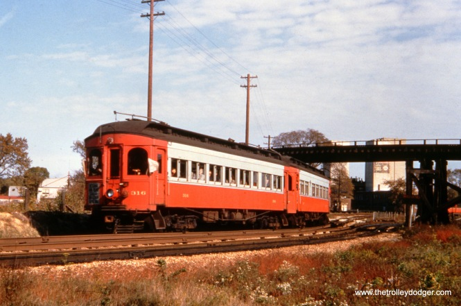 "CA&E 316 and 317 have just departed Forest Park and are heading west in the 1950s. CTA Garfield Park ""L"" cars would loop using the wooden trestle at rear. This is the approximate location of I290 today."