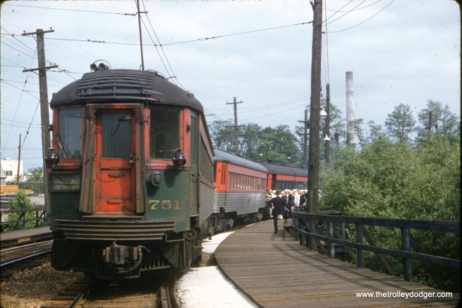 Sailors board a North Shore Line train at Great Lakes on June 1, 1962. Car 751 is at rear.