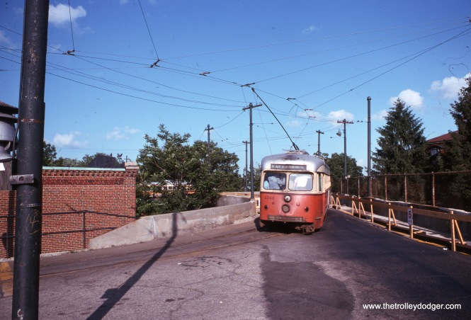3345 at Ashmont in August 1968 with a standing room crowd. Despite the roll sign, the Ashmont-Mattapan tracks are separate from Boston's Green Line system.