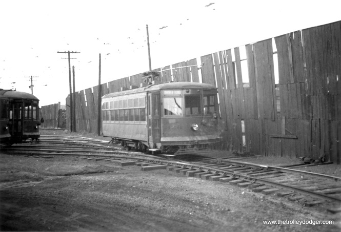 #4 North Chicago barns, Birney car that later went to Milwaukee, Wis. Scrapped in 1947. Photo taken in September 1939. Car shown in 2 at left.
