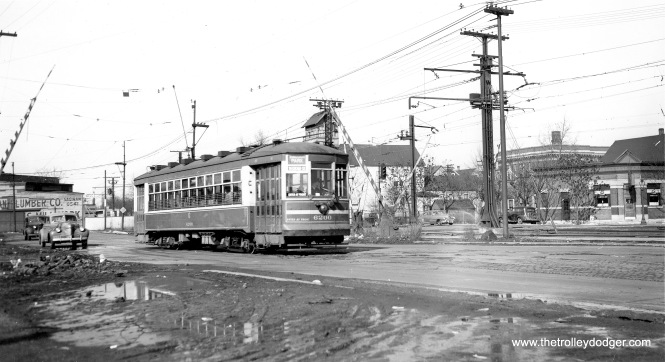 "CSL 6200 on the Windsor Park line. This was a Multiple-Unit car. Don's Rail Photos adds, ""6200 was built by CSL in 1924. It was rebuilt as one man service in 1932."" Andre Kristopans adds, ""One funny thing about this location, when the CTA started the automated stop announcements on the buses, the southbound stop, which is where the B&O crossing was a bit south of 83rd Place, is announced as ""Commercial Avenue at Railroad crossing"", even though the tracks have been gone since the 1970's sometime!"" (Joe L. Diaz Photo)"