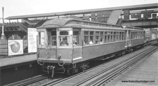 "This is an inspection train at the Lake Street Transfer ""L"" station, which provided connections between the Lake Street ""L"", on the lower level, and the Metropolitan above. The higher level station was closed in February 1951, when the Dearborn-Milwaukee subway opened."