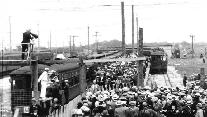 The throngs of people in this June 1926 photograph were attending the Catholic Church's 28th International Eucharistic Congress in Mundelein. Note the variety of rail cars being used to move the masses. After the Congress ended, ridership on the North Shore Line's Mundelein-Libertyville branch was sparse enough that service was provided by a single city streetcar.