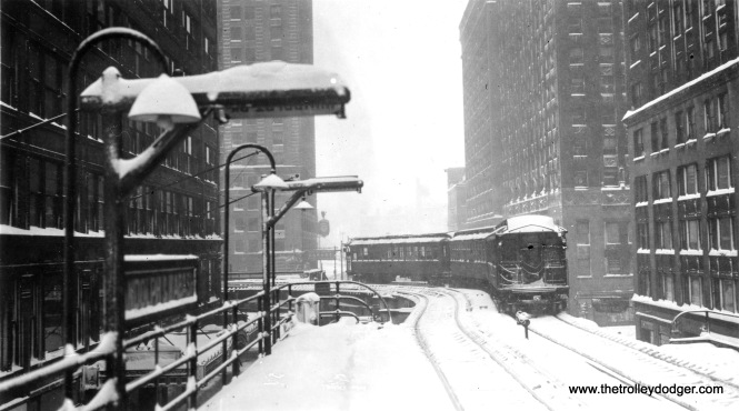 "A snowy scene at Wabash and Lake, site of the tightest curve on the ""L""."