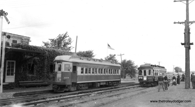 CA&E wood car 318, at right, is making a photo stop at Clintonville on the Elgin branch, during an early Central Electric Railfans' Association fantrip. Presumably the 415 at left is a regular service car.