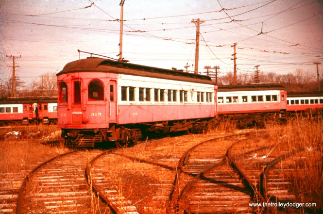 "The end result. This photo of Chicago, Aurora & Elgin wood car 315 was taken by Earl W. Clark in December 1960. Don's Rail Photos: ""315 was built by Kuhlman Car Co in 1909, #404. It was modernized at an unknown date and sold to Rockhill Trolley Museum in 1962."""
