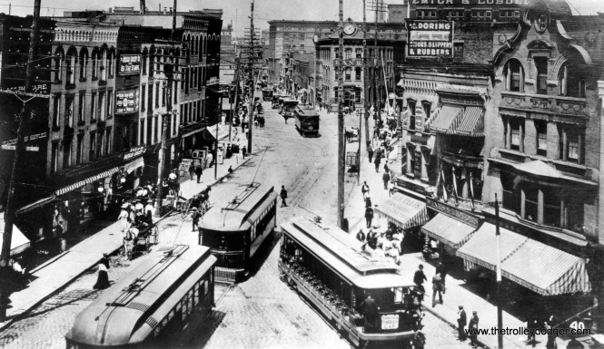 "Photo caption: ""Franklin Sqaure is one block south of (the )railroad crossing on River Street. Troy (NY)."""