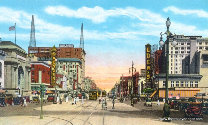 A postcard view of Canal Street, showing the same general area as the 1940 slide, but looking from the opposite direction.