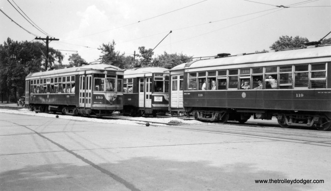 "C&WT 153, 140 and 119 on the LaGrange line. Comparison with some other photos in this series shows this location is DesPlaines Avenue just south of 26th Street in Riverside. We are looking north. Don's Rail Photos: ""153 was built by Cummings Car Co in 1927. It was scrapped in 1948. 140 was built by McGuire-Cummings in 1924. It was rebuilt in 1939 and scrapped in 1948. 119 was built by McGuire-Cummings in 1912. It was scrapped in 1948."" (Joe L. Diaz Photo)"
