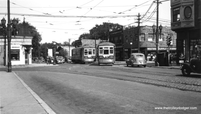 "C&WT 134 and 124 meet at Madison and Harlem. Note how Madison took a jog when crossing between Oak Park and Forest Park. We are looking east. Don's Rail Photos: ""124 was built by McGuire-Cummings in 1914. It was rebuilt in 1936 and scrapped in 1948."" (Joe L. Diaz Photo)"