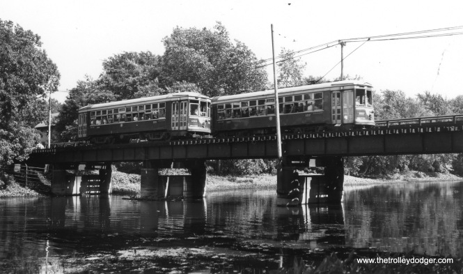 C&WT 158 and 157 cross on the bridge over the DesPlaines River (LaGrange line). I believe we are looking south. (Joe L. Diaz Photo)
