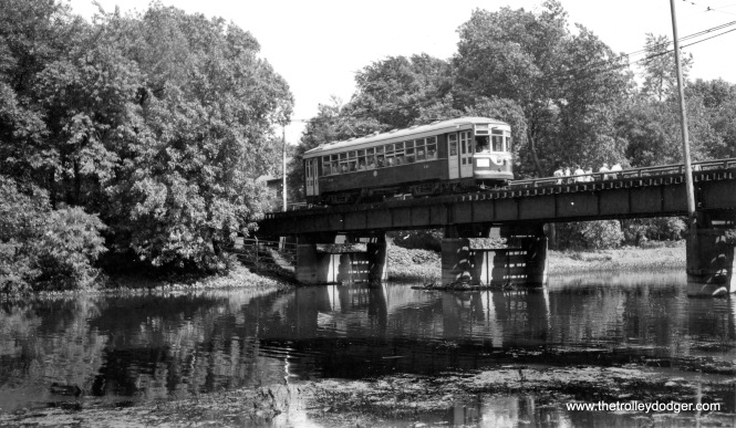 C&WT 141 is westbound, crossing the DesPlaines River on the LaGrange line. This car, sole survivor of the fleet, has been restored and you can ride it at the Illinois Railway Museum. (Joe L. Diaz Photo)