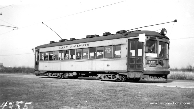 "Gary Railways car 19, the only car preserved, on a Central Electric Railfans' Association fantrip. This matches a picture we previously published in our previous post More Hoosier Traction (September 2, 2015). Bill Shapotkin said that other picture was taken ""taken on March 19, 1939 -- the day AFTER the last day of service on the Indiana Harbor (and Hobart) lines."" The difference in tonality between the two pictures may simply be the difference between panchromatic and orthochromatic film."
