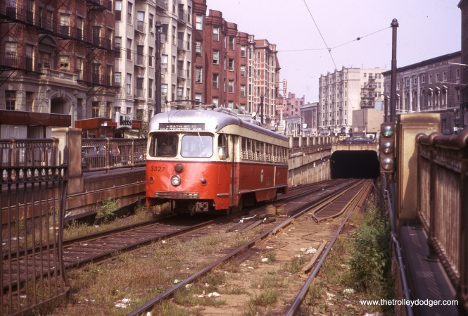 "Boston double-end PCC 3327, signed for Heath on the MBTA Green Line ""E"" branch (formerly called Arborway), is heading up the Northeastern Incline from the Huntington Avenue Subway in this March 1974 view."
