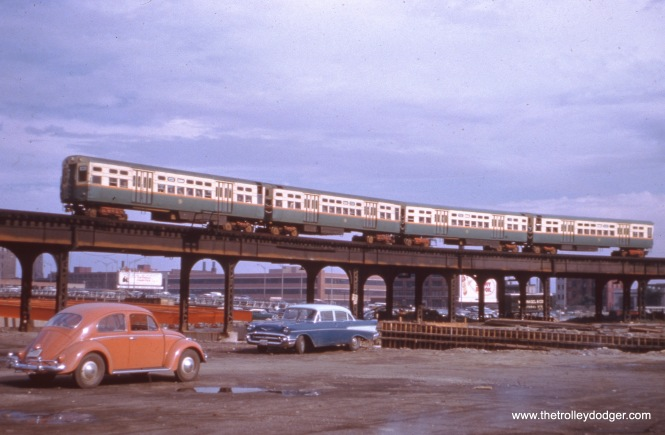 "This 1958 picture shows the old Garfield Park ""L"" crossing the area now occupied by the Kennedy expressway. The ""L"" was replaced by the Congress Expressway median line on June 22, 1958, after which these tracks were removed. But prior to that, they had to be shored up with new supports due to excavation work for the new highway, which opened on November 5, 1960. We ran another picture taken at this location in our previous post Some Thoughts on ""Displaced"" (August 30, 2016). You can also see a 1957 Chevy in the picture, plus an early Volkswagen. The last year for the split rear window Beetles was 1953, so this one is later."