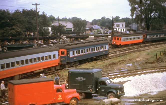 This picture of various Chicago, Aurora & Elgin trains was taken around September 1953 at DesPlaines Avenue in Forest Park. Construction is underway to reconfigure the terminal for a new track arrangement, where CA&E trains will no longer head downtown, but will terminate and loop here. The wooden ramp in the background was built so that CTA trains could loop without crossing CA&E tracks, which were no longer going to be connected to the CTA. This new arrangement continued until the CA&E quit operating passenger service on July 3, 1957.