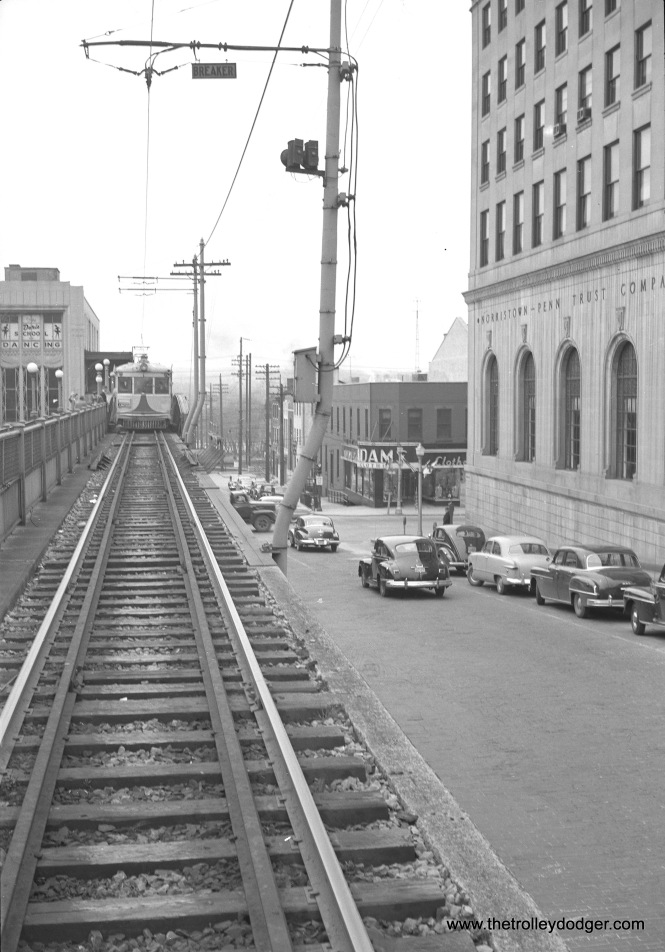 The ramp you see is at Norristown, and shows how Lehigh Valley Transit interurban cars descended to street level to continue north to Allentown. Service on the Liberty Bell Limited ended in September 1951. Service between Philadelphia and Norristown, started by the Philadelphia & Western, continues today under SEPTA.